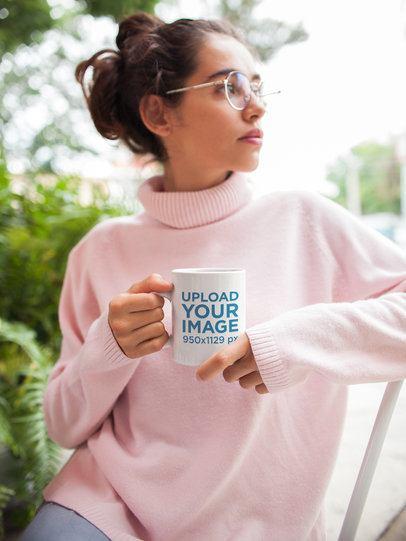Mockup of a Coffee Mug Held by a Woman Wearing a Turtleneck Sweater 22425