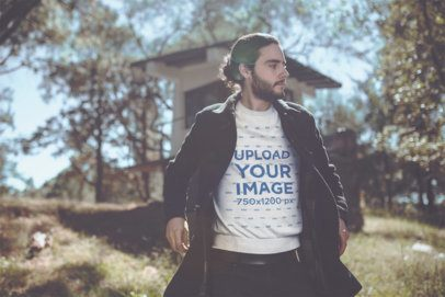 Mockup of a Man Wearing a Crewneck Sweater and a Jacket Walking Outdoors 18037