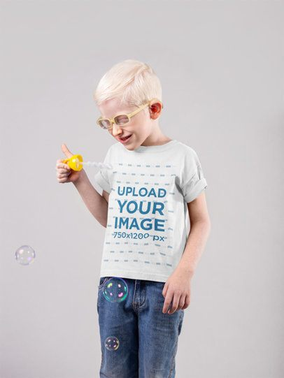 Mockup of a Little Boy Wearing a T-Shirt and Happily Blowing Bubbles 22061