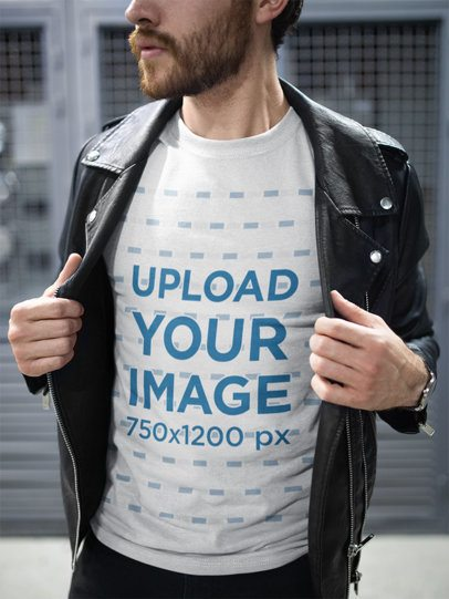 T-Shirt Mockup of a Man Wearing a Leather Jacket on the Street 20055
