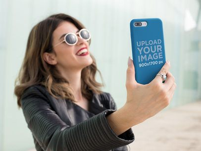Phone Case Mockup Featuring a Woman Taking a Selfie and Smiling 22897