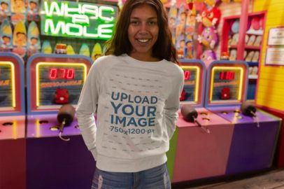 Mockup of a Smiling Girl Wearing a Crewneck Sweater at an Amusement Park 18219