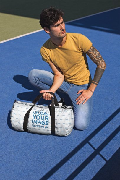 Mockup of a Man Picking up a Gym Bag 23222