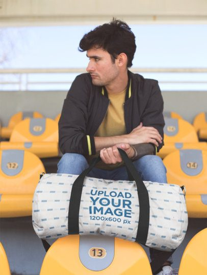Mockup of a Serious Man Holding a Duffle Bag at a Stadium 23248