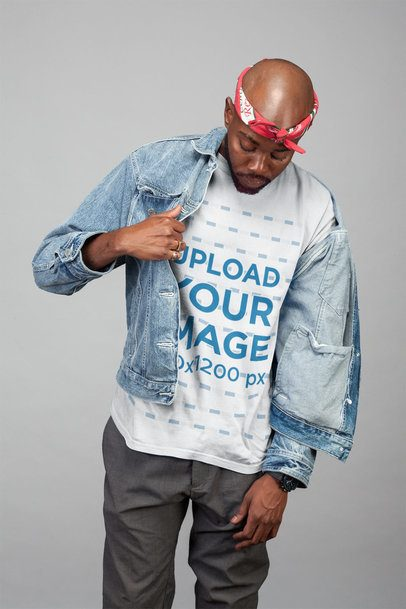 Mockup of a Man Wearing a Tshirt and a Denim Jacket in a Studio 21664