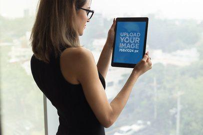 Mockup of an Executive Businesswoman Using an iPad 22814