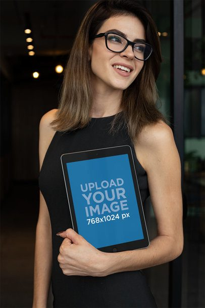 Mockup of a Businesswoman Holding an iPad 22817