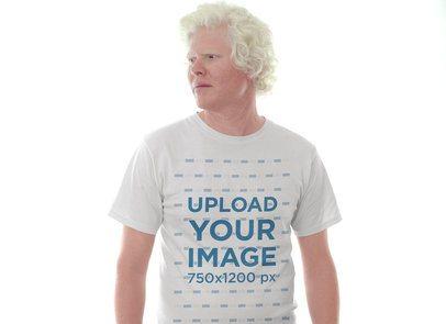 Tshirt Mockup of a Man Wearing a Tshirt Against a Bright Light 22237