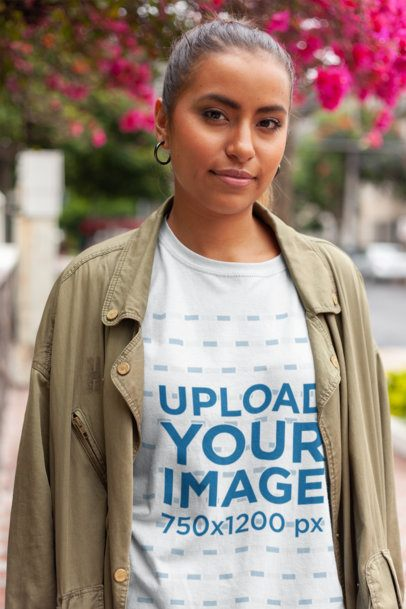 Unisex T-Shirt Mockup Featuring a Woman Out and About with a Casual Look 22786