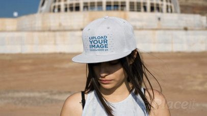 Video of a Hispanic Girl Wearing a Snapback Hat at an Abandoned Place 14199