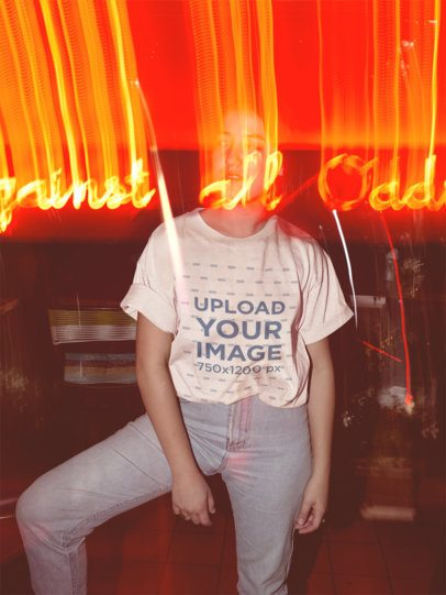 Cool Mockup of a Trendy Woman Wearing a Tee While out at Night 18856