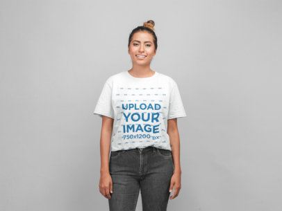 Mockup of a Smiling Woman Wearing a Tshirt in a Photo Studio 22773