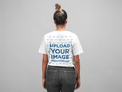 Unisex T-Shirt Back View Mockup of a Girl Facing Towards Seamless Paper 22776