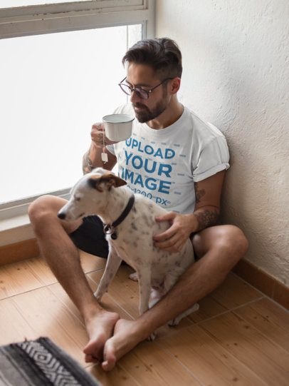 T-Shirt Mockup Featuring a Man Drinking Tea Sitting by his Dog 18086