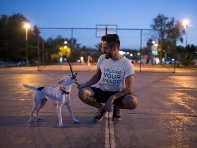 Round Neck Tee Mockup Featuring a Man Playing with his Dog at a Court 18088