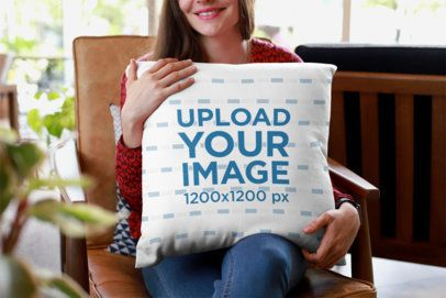Mockup of a Smiling Woman Holding a Pillow 23605