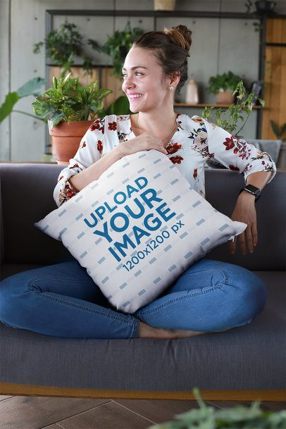 Mockup of a Smiling Woman Holding a Pillow at a Lounge 23611