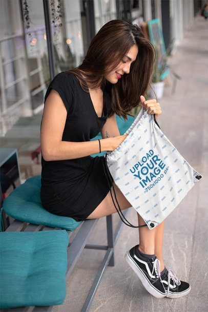 Mockup of a Girl Looking Inside a Drawstring Bag 23667