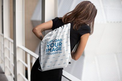 Drawstring Bag Mockup of a Girl Looking Over a Guarding Rail 23668