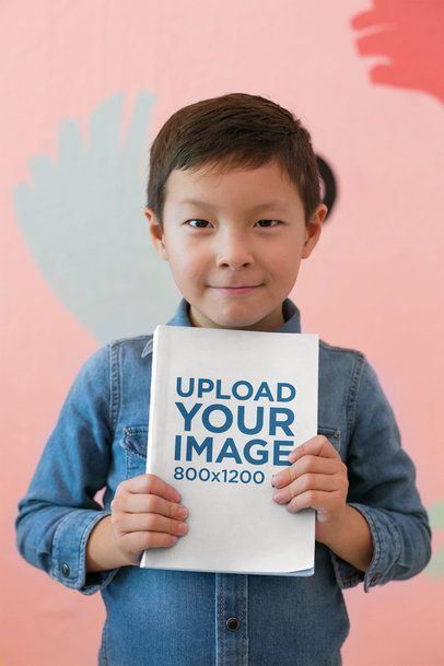 Book Mockup of a Happy Kid Showing off His Book 23717