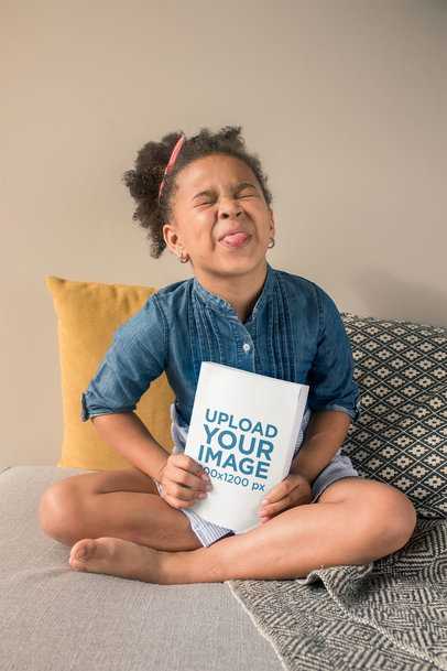 Book Mockup Featuring a Cute Little Girl Sticking Her Tongue Out 23722