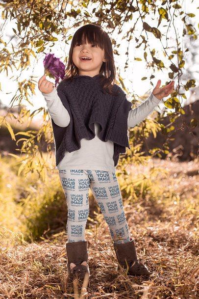 Mockup of a Cute Girl Wearing Leggings Holding a Flower 23935