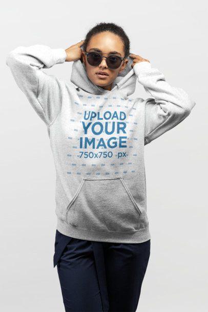 Mockup of a Woman Adjusting Her Hoodie While Wearing Trendy Sunglasses 24293
