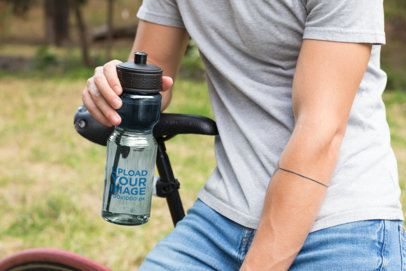 Mockup of a Transparent Sports Bottle Being Held by a Man 24430