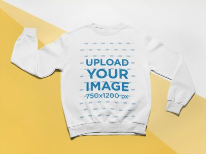 Mockup of a Crewneck Sweatshirt Laid Flat over a Tricolored Background 24575