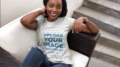 Parallax Video of a Woman Posing with a T-Shirt on a Sofa 25072