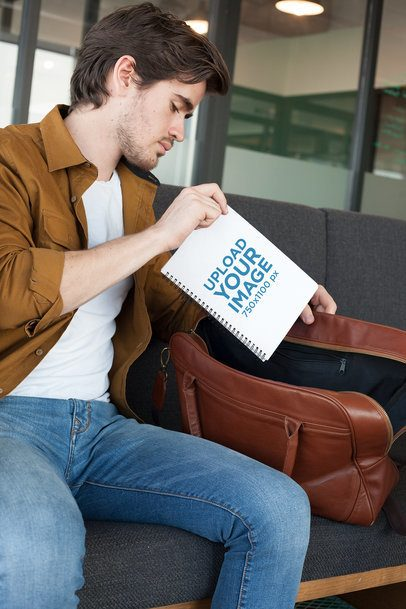 Mockup of a Man Putting Away His School's Notebook 24161