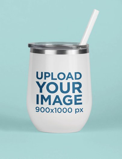 Mockup of a Tumbler with a Straw Standing on a Solid Surface 24404