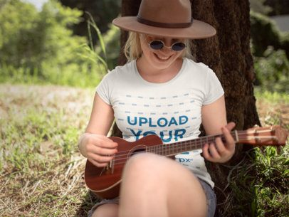 T-Shirt Mockup of a Woman Playing the Ukulele 21990