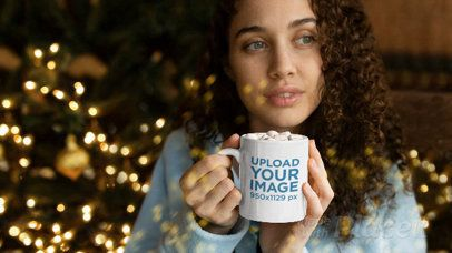 Mug Parallax Video Mockup of a Girl Enjoying Cocoa Next to the Christmas Tree 25652