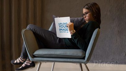 Parallax Video Mockup Featuring a Girl Reading a Book in a Cool Chair 25879