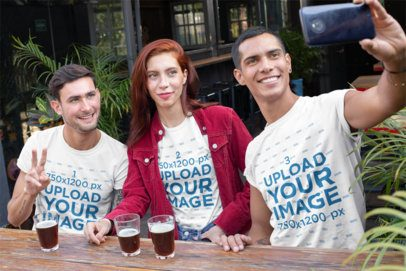 T-Shirt Mockup of Three Friends Taking a Selfie at a Bar 25254