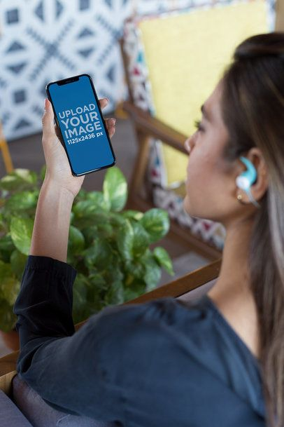 Mockup of an iPhone X Featuring a Woman Listening to a Podcast 24796
