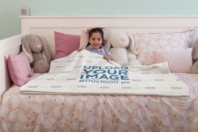 Mockup of a Happy Little Girl Lying Under a Throw Blanket on her Bed 24688