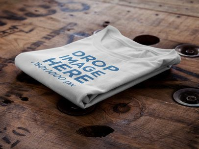 T-Shirt Mockup of a Folded T-Shirt Over a Wooden Surface 6485a