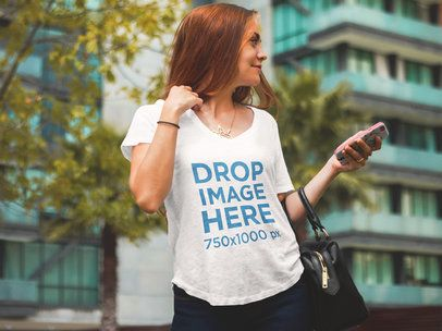 T-Shirt Mockup of a Beautiful Woman at an Urban Environment 6064a