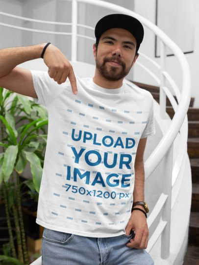 T-Shirt Mockup of a Happy Customer with a Cap at the End of a Staircase 26227