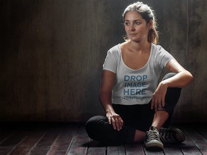 T-Shirt Mockup of a Girl Wearing Activewear While Sitting Down 6548a