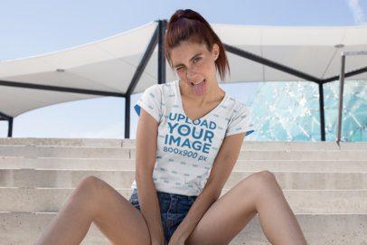 Sublimated V-Neck T-Shirt Mockup of a Girl Making a Crazy Face 24978