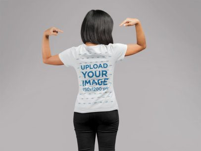 Back View Mockup of a Woman Lifting Her Arms and Pointing at Her Tee 21727