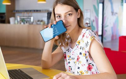 iPhone XS Mockup of a Blonde Girl in a Coworking Space  25443