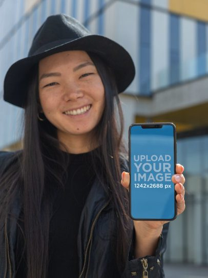 iPhone XS Max Mockup Featuring a Trendy Girl Showing off Her Screen 25766