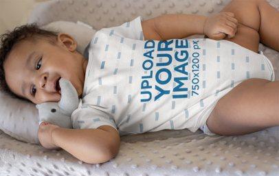 Onesie Mockup of a Baby Boy Lying on a Soft Cushion 25113