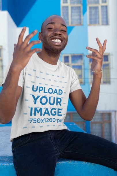 T-Shirt Mockup of a Man Smiling with a Cool Pose 26363