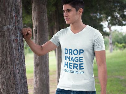 T-Shirt Mockup Featuring a Young Man at a Park a5582