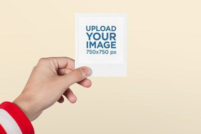 Mockup of a Polaroid Picture Frame Held by a Man with a Red Jacket 26178